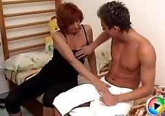 Mature hottie pulls a young dude out of the showers and makes him bang her
