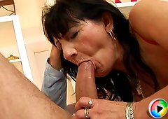 MILF with pierced and tattooed pussy in red outfit