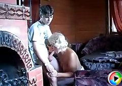 Older lady seduces a young guy with her tits and her mature cunt is aching with a young hard cock