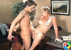 Naughty Bitch Julie Mandrews loves being fucked hard on top of her desk!