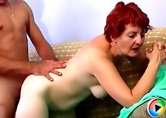 Sexy redhead MILF gets fucked by a her sweet young lover and gets a sticky cumshot on her tits