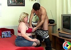 She is old, fat and horny and he is fucking her with his throbbing young dick meat